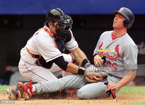 New York Mets' catcher Mike Piazza tags out St Louis Cardinals runner Rich Ankiel who tried to score on a flyout by Ray Lankford in the top of the...