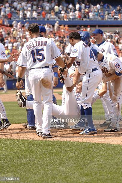 New York Mets celebrate Jose Valentin's gamewinning single in 10th inning of Mets 10 victory at Shea Stadium FLushing New York on July 26 2006