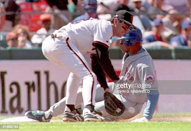 New York Mets Chris Jones slides safely into third base beating the tag from San Francisco Giants third baseman Steve Scarsone 05 June in San...