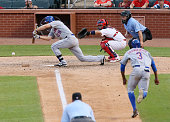 New York Mets' Curtis Granderson foreground right takes off on a suicide squeeze play as Eric Campbell lays down a successful bunt to drive in a run...