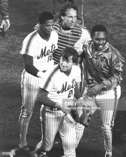 New York Mets' Darryl Strawberry Gary Carter Kevin Mitchell and Series MVP Ray Knight celebrate Mets 85 win over the Boston Red Sox in Game Seven of...