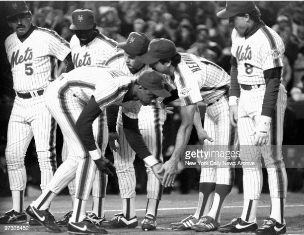 New York Mets' Darryl Strawberry gets a lowfive from teammate Keith Hernandez as Gary Carter looks on during pregame introductions at Shea Stadium...