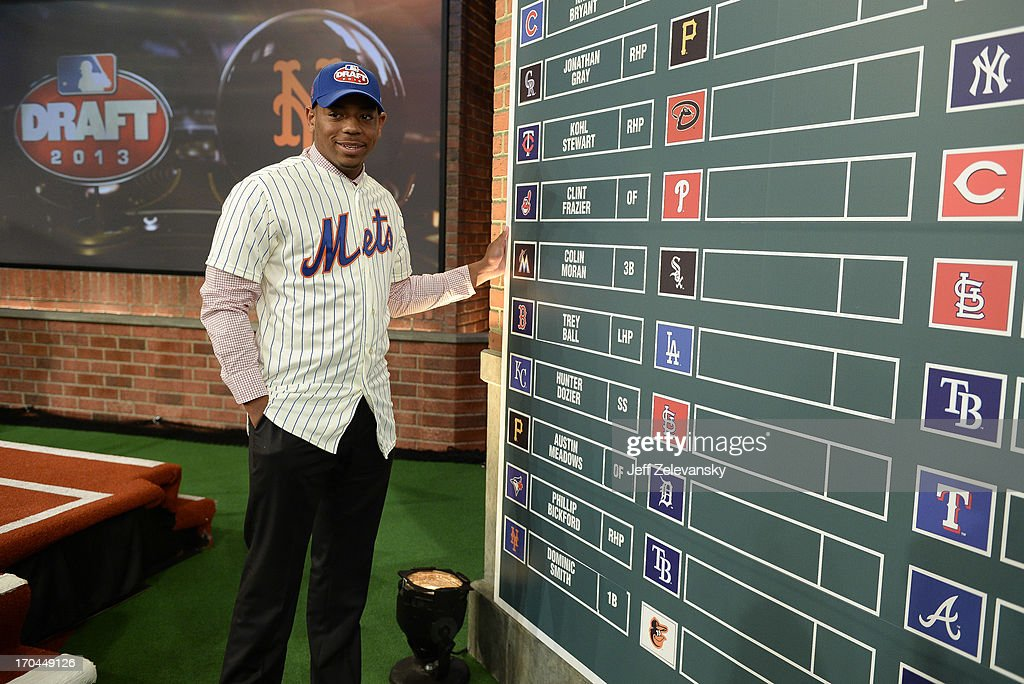 New York Mets draftee Dominic Smith poses near the draft board at the 2013 MLB First-Year Player Draft at the MLB Network on June 6, 2013 in Secaucus, New Jersey.