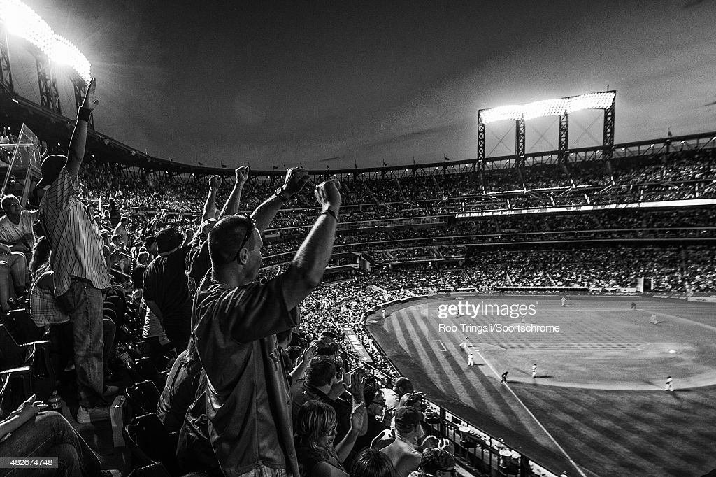 New York Mets fans react to a Kelly Johnson home run in the fifth inning during the game against the Los Angeles Dodgers at Citi Field on July 25, 2015 in the Queens borough of New York City.