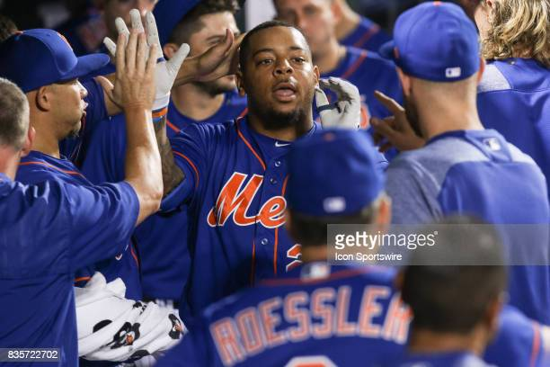 New York Mets First Baseman Dominic Smith receives high fives in the dugout after homering during the eighth inning of the Major League Baseball game...