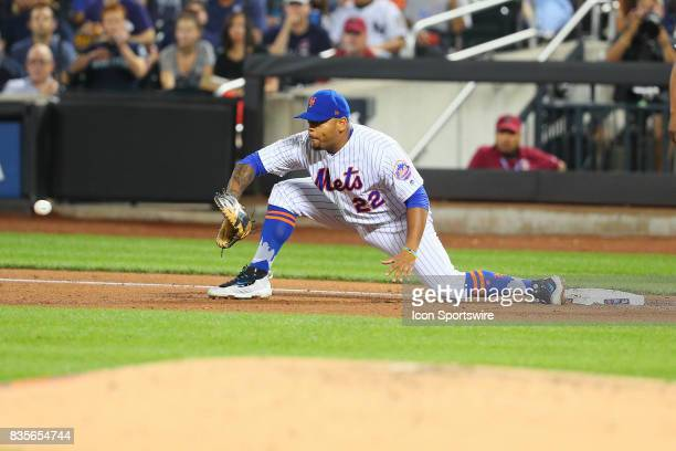 New York Mets first baseman Dominic Smith stretches at first during the Major League Baseball game between the New York Mets and the New York Yankees...
