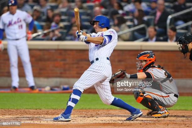 New York Mets first baseman TJ Rivera doubles during the Major League Baseball game between the New York Mets and the San Francisco Giants on May 8...