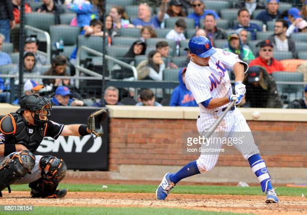 New York Mets First Baseman TJ Rivera lines the ball during the matchup between New York Mets and the Miami Marlins on May 7 2017 at Citi Field in...