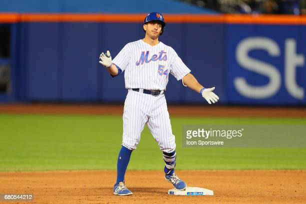 New York Mets first baseman TJ Rivera slaps his hands together at second base during the Major League Baseball game between the New York Mets and the...