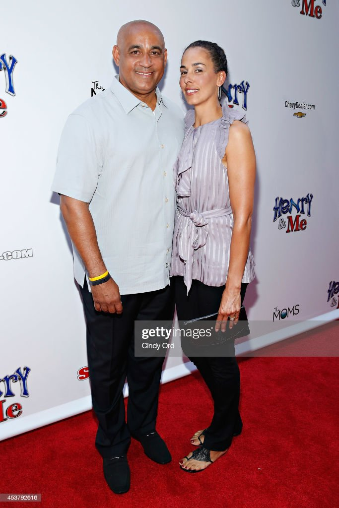 New York Mets General Manager <a gi-track='captionPersonalityLinkClicked' href=/galleries/search?phrase=Omar+Minaya&family=editorial&specificpeople=228469 ng-click='$event.stopPropagation()'>Omar Minaya</a> and Rachel Minaya attend the 'Henry & Me' New York Premiere at Ziegfeld Theatre on August 18, 2014 in New York City.