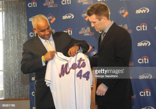 New York Mets GM Omar Minaya hands Jason Bay his Mets uniform shirt at Citi Field on January 5 2010 in New York City