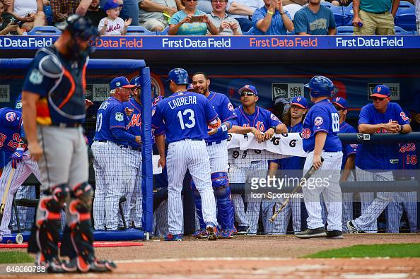 New York Mets infielder Asdrubal Cabrera is congratulated in the dugout following his first inning solo home run during a Spring Training game...