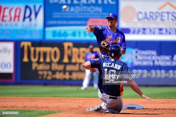 New York Mets infielder David Wright turns a double play as Houston Astros catcher Brian McCann 16 slides into second during a Spring Training game...