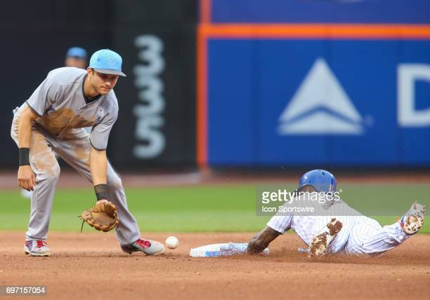 New York Mets Infielder Jose Reyes singles and advances to second base on a throwing error by Washington Nationals Pitcher Blake Treinen during the...