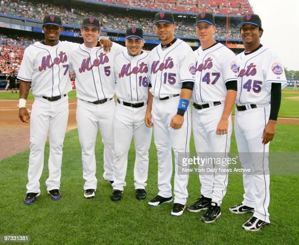 New York Mets' Jose Reyes David Wright Paul Lo Duca Carlos Beltran Tom Glavine and Pedro Martinez line up on the field at Shea Stadium before the...