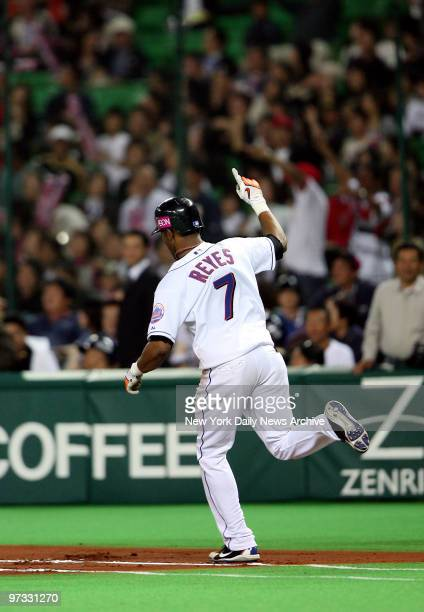 New York Mets' Jose Reyes rounds the bases after hitting a walkoff home run in the bottom of the 10th inning to win Game 5 of the 2006 AllStar Series...