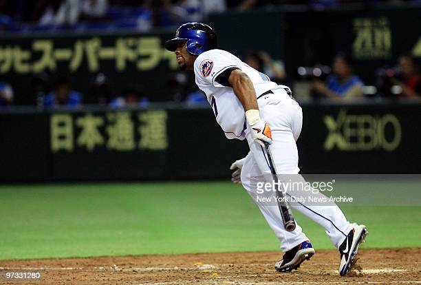 New York Mets' Jose Reyes singles in the fifth inning of Game 1 of the Japan AllStar Series between the MLB AllStars and the Nippon Professional...