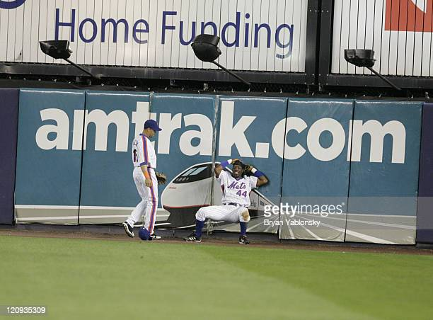 New York Mets Lastings Milledge failing to catch home run hit by Garrett Atkins during a regular season MLB game against the Colorado Rockies played...