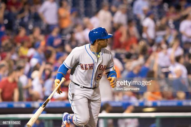 New York Mets Left field Yoenis Cespedes drops his bat after hitting his second home run in the fourth inning during the game between the New York...