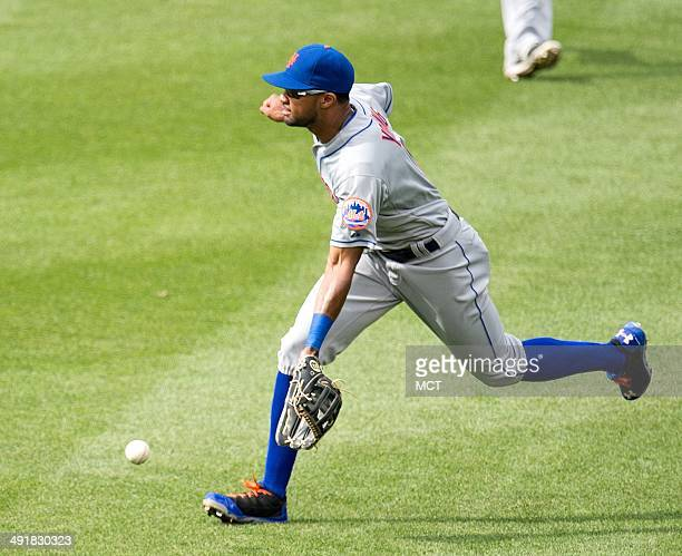 New York Mets left fielder Chris Young can't get to a ball hit to rightcenter field by Washington Nationals first baseman Tyler Moore during the...