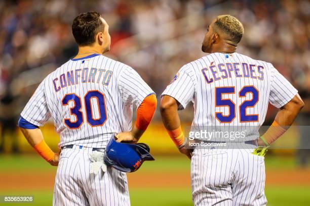 New York Mets left fielder Michael Conforto and New York Mets left fielder Yoenis Cespedes during the Major League Baseball game between the New York...
