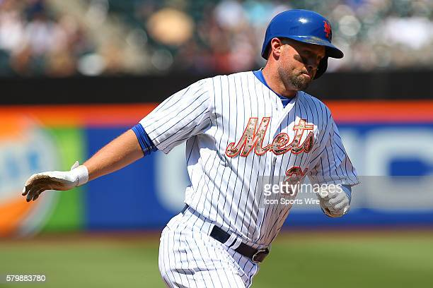 New York Mets left fielder Michael Cuddyer rounds third base after hitting a homerun during the game between the New York Mets and the Philadelphia...