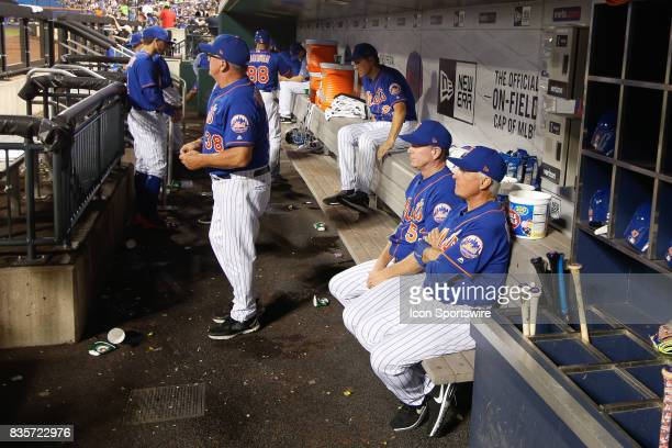 New York Mets Manager Terry Collins right watches from the dugout during the Major League Baseball game between the Miami Marlins and the New York...