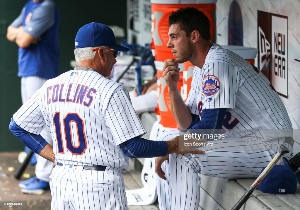 New York Mets Manager Terry Collins (10) taps New York Mets Starting Pitcher Steven Matz (32) on the knee after pulling his starter in the second inning go the game between the Colorado Rockies and the New York Mets on July 16, 2017 at Citi Field in Flushing, NY.