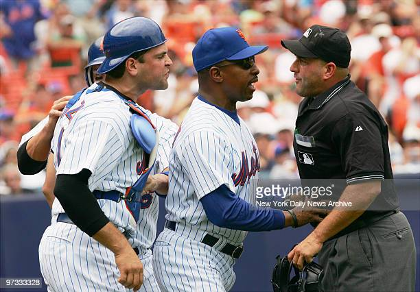 New York Mets' manager Willie Randolph gets between home plate umpire Eric Cooper and Met's catcher Mike Piazza after Cooper ejected Piazza in the...