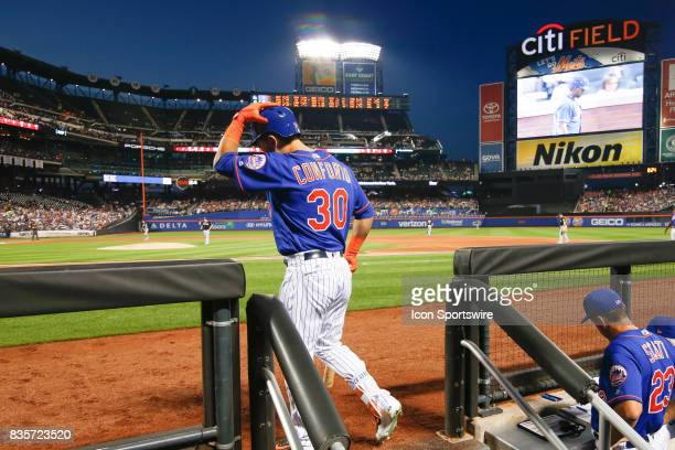 New York Mets Outfielder Michael Conforto heads fir the ondeck circle during the Major League Baseball game between the Miami Marlins and the New...