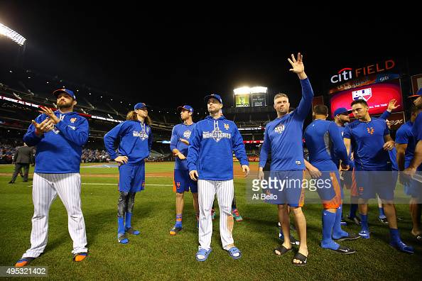 New York Mets players Jonathon Niese Jacob deGrom and David Wright wave to fans after Game Five of the 2015 World Series at Citi Field on November 1...