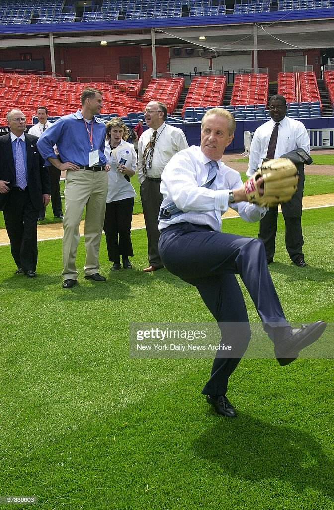New York Mets' President Fred Wilpon practices his pitching at Shea Stadium as the Mets and JPMorgan Chase mark the sixth year of the 'Baseball is...