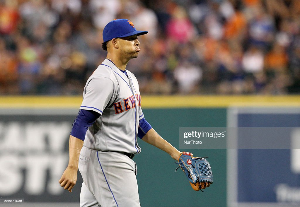 New York Mets relief pitcher Hansel Robles heads to the dugout after the eighth inning of a baseball game against the Detroit Tigers in Detroit...