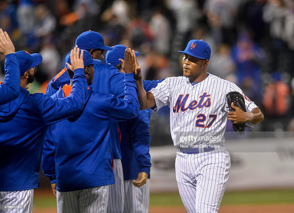 New York Mets relief pitcher Jeurys Familia high fives teammates at games end New York Mets vs Philadelphia Phillies @ Citifield Tuesday April 14...