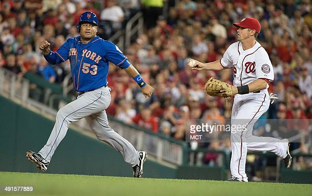 New York Mets right fielder Bobby Abreu is chased in a rundown play between first and second base as he tries to elude Washington Nationals first...