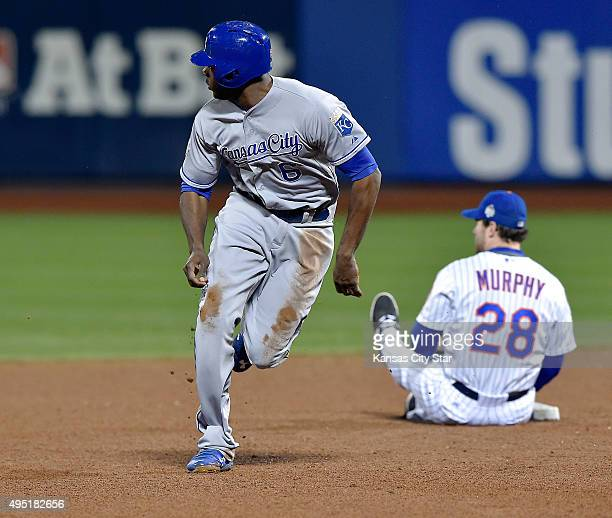 New York Mets second baseman Daniel Murphy sits on the ground after missing the catch on a pickoff attempt on the Kansas City Royals' Lorenzo Cain in...