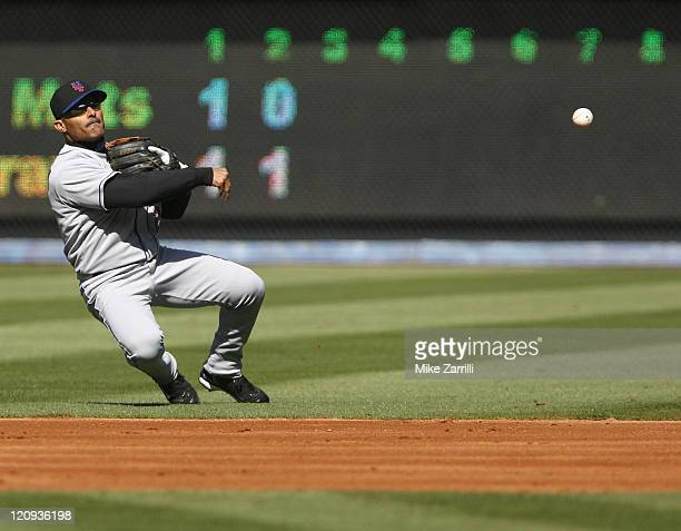 New York Mets second baseman Jose Valentin throws off balance during the game between the Atlanta Braves and the New York Mets at Turner Field in...