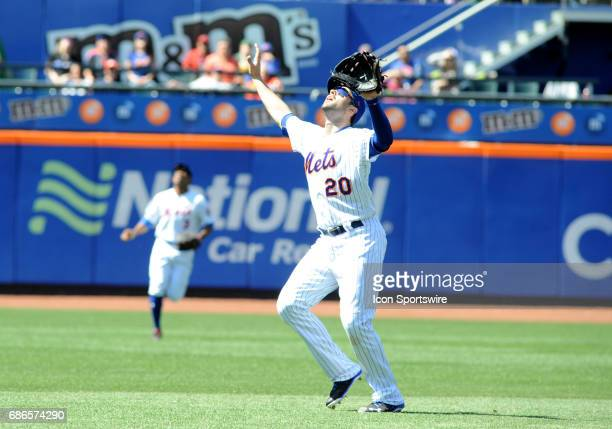 New York Mets second baseman Neil Walker fields a pop up during the game between New York Mets and the Anaheim Angels on May 21 2017 at Citi Field in...
