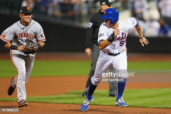 New York Mets second baseman TJ Rivera gets caught in a run down during the National League Wild Card Game between the New York Mets and the San...