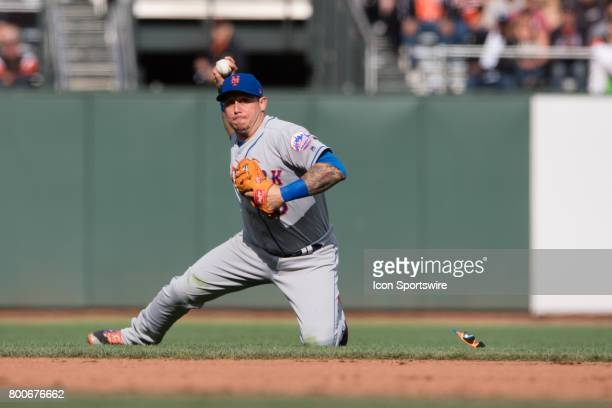 New York Mets shortstop Asdrubal Cabrera makes a diving catch and throws to first base during the game between the New York Mets and the San...