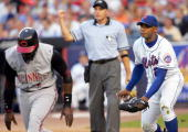 New York Mets' starter Orlando Hernandez earns an unassisted double play as home plate umpire Dan Iassogna calls Cincinnati Reds' Brandon Phillips...