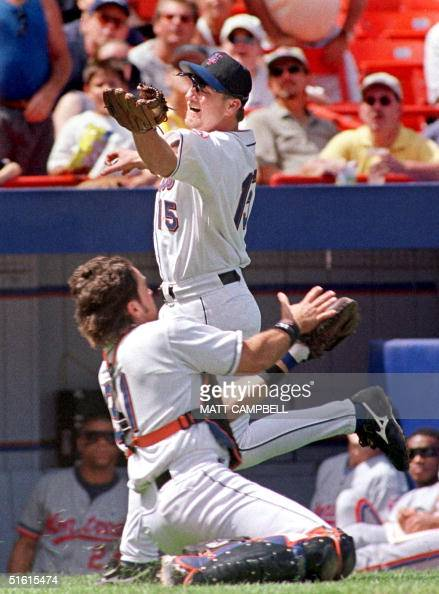New York Mets third baseman Matt Franco narrowly avoids colliding with Mets catcher Mike Piazza as Franco catches a foul pop off the bat of the...