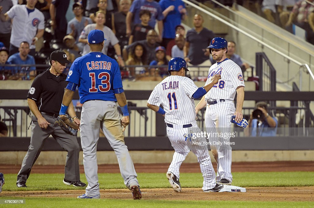 New York Mets third baseman Ruben Tejada caught stealing between 3rd and home ends up on third base with New York Mets second baseman Daniel Murphy...