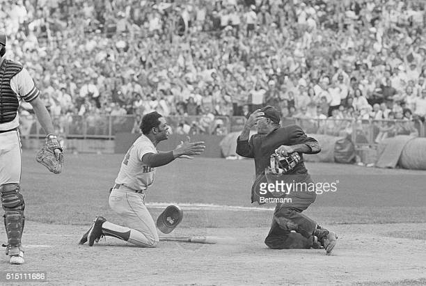 New York Mets Willie Mays and home plate umpire Augie Donatelli are on their knees and appear to plead with each other after the umpire called Bud...