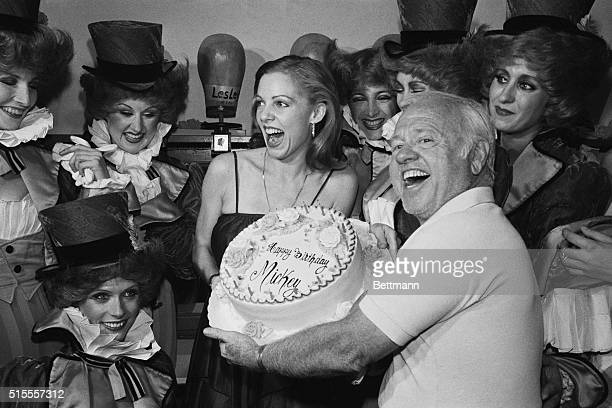 Mickey Rooney gets birthday cake from some of the cast of Sugar Babies during birthday celebration Rooney celebrated his 60th birthday