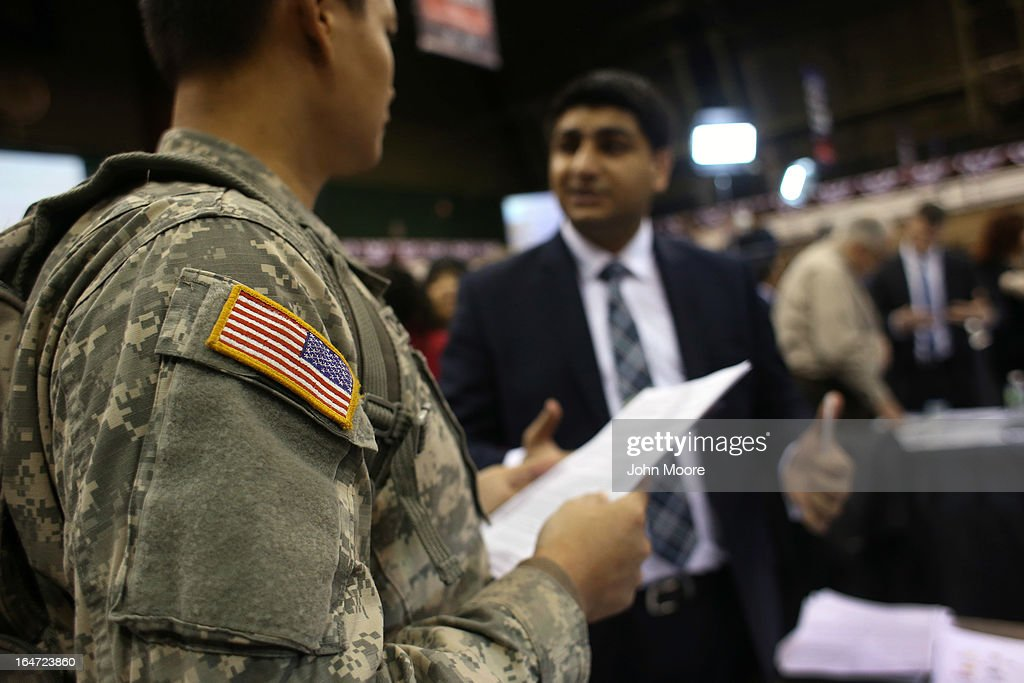 New York National Guard Spc. Kyle Chen (L) meets potential employer Amrit Singh during the Hiring Our Heroes military job fair held on March 27, 2013 in New York City. Hundreds of veterans and their spouses turned out to meet more than 100 employers participating at the second annual event, hosted by the U.S. Chamber of Commerce National Chamber Foundation. Lead sponsors were Capital One Financial Corporation and Toyota.