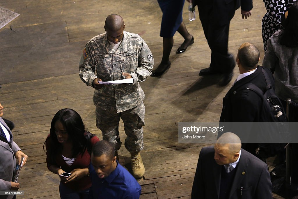 A New York national guardsman prepares to meet potential employers at the Hiring Our Heroes job fair held on March 27, 2013 in New York City. Hundreds of veterans and their spouses turned out to meet more than 100 employers participating at the second annual event, hosted by the U.S. Chamber of Commerce National Chamber Foundation. Lead sponsors were Capital One Financial Corporation and Toyota.
