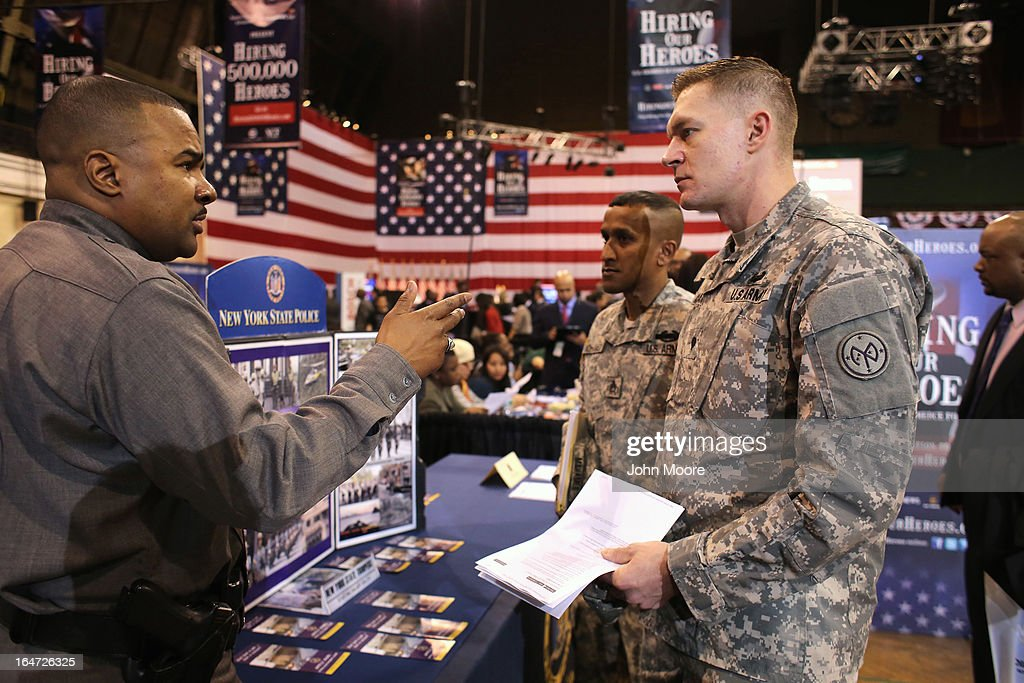 New York national guardsmen meet a state police recruiter at the Hiring Our Heroes job fair held on March 27, 2013 in New York City. Hundreds of veterans and their spouses turned out to meet more than 100 employers participating at the second annual event, hosted by the U.S. Chamber of Commerce National Chamber Foundation. Lead sponsors were Capital One Financial Corporation and Toyota.