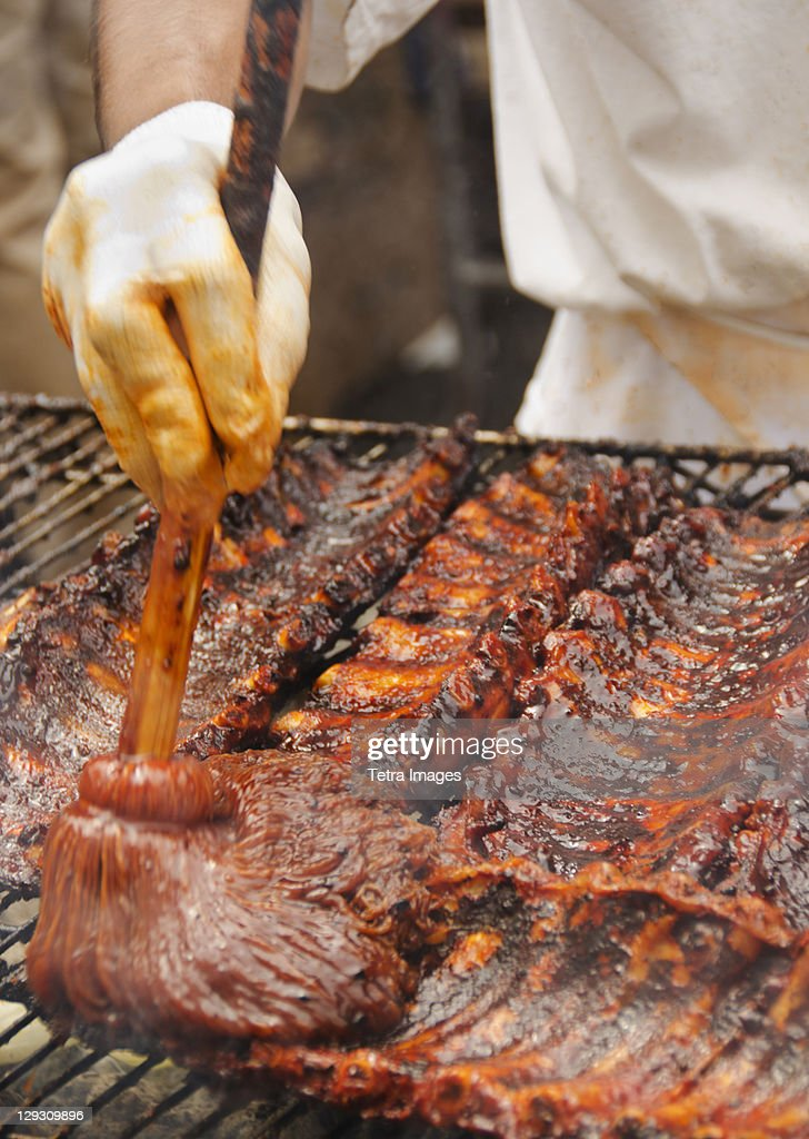 USA, New York, New York City, Chef cooking spareribs on barbeque : Stock Photo