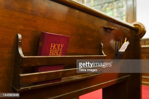 USA, New York, New York City,  Close up of bible on wooden church pew
